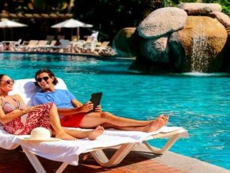 Couple at pool Free Velas All Inclusive Stays